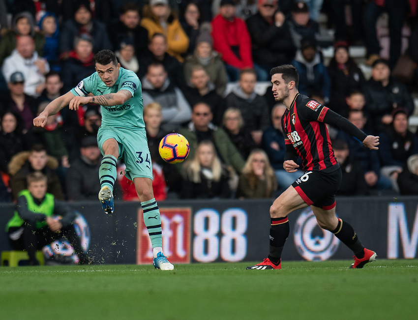 Arsenal's GranitXhaka (left) crosses the ball despite the attentions of Bournemouth's Lewis Cook (right) <br /> <br /> Photographer David Horton/CameraSport<br /> <br /> The Premier League - Bournemouth v Arsenal - Sunday 25th November 2018 - Vitality Stadium - Bournemouth<br /> <br /> World Copyright © 2018 CameraSport. All rights reserved. 43 Linden Ave. Countesthorpe. Leicester. England. LE8 5PG - Tel: +44 (0) 116 277 4147 - admin@camerasport.com - www.camerasport.com