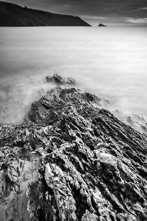 British coastal scene with rocky coastline looking across bay to headland