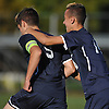 Adam Feldstein #9 of Plainview JFK, left, gets congratulated by teammate Michael Muhlbach #14 after he scored a goal in the first half of a Nassau County Conference AA-3 boys soccer game against host Westbury High School on Friday, Oct. 14, 2016. Plainview JFK won by a score of 1-0.