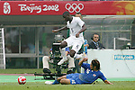 07 August 2008: Maurice Edu (USA) (6) leaps over the tackle from Takuya Honda (JPN) (16).  The men's Olympic team of the United States defeated the men's Olympic soccer team of Japan 1-0 at Tianjin Olympic Center Stadium in Tianjin, China in a Group B round-robin match in the Men's Olympic Football competition.