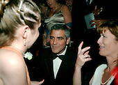George Clooney speaks with an unidentified young woman at the Newsweek party at the Washington Hilton Hotel in Washington, D.C. prior to the annual White House Correspondents Association (WHCA) dinner, April 28, 2006..Credit: Ron Sachs / CNP.(RESTRICTION: NO New York or New Jersey Newspapers or newspapers within a 75 mile radius of New York City)