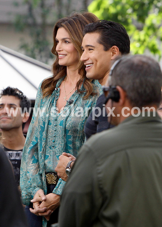**ALL ROUND PICTURES FROM SOLARPIX.COM**                                             **SYNDICATION RIGHTS FOR UK AND SPAIN ONLY**                                                                                  Caption: Mario Lopez and Cindy Crawford filling a segment for TV at the Grove, CA, USA, 25 October 2010                                                                              This pic: Cindy Crawford                                                                                             JOB REF: 12376       STL       DATE:  25_10_2010                                                          **MUST CREDIT SOLARPIX.COM OR DOUBLE FEE WILL BE CHARGED**                                                                      **MUST AGREE FEE BEFORE ONLINE USAGE**                               **CALL US ON: +34 952 811 768 or LOW RATE FROM UK 0844 617 7637**