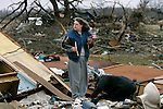 Kim Veverka tries to sort through what is left of her home off of Highway 104 in Atkins, Ark. Wednesday, Feb 06, 2008. Veverka was at a friend's house when her house was ripped apart by a tornado Tuesday night.