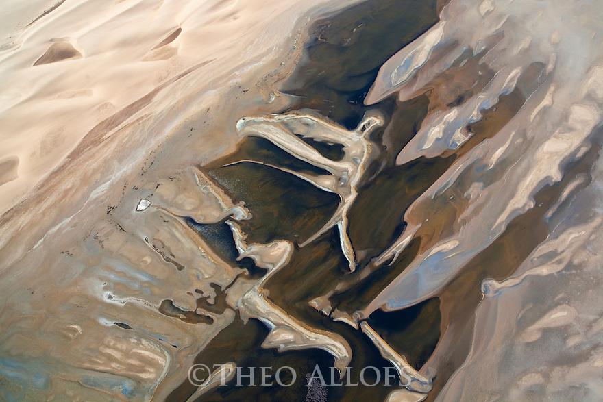 Namibia, Namib Desert, Skeleton Coast, aerial view of Sandwich Harbour; a natural bay at the edge of the Namib Desert