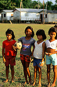 Ariau, Amazon, Brazil. Four caboclo girls from a small village on the Rio Negro with a football.