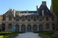 A part of the court of the Hotel de Sully, in the Marais, Paris, with a view on the inner garden. The building dates back to the XVII century. Digitally Improved Photo.
