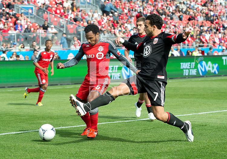 05 May 2012: D.C. United midfielder Dwayne De Rosario #7 and Toronto FC midfielder Julian de Guzman #6 in action during an MLS game between DC United and Toronto FC at BMO Field in Toronto.