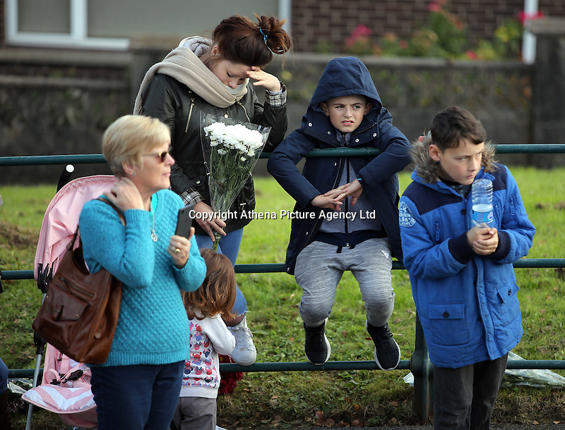 Pictured: A young woman and two boys gather to see Prince Charles at the Memorial Garden in Aberfan Friday 21 October 2016<br />Re: Wales has fallen silent as the country remembered the Aberfan disaster 50 years ago.<br />On 21 October 1966, a mountain of coal waste slid down into a school and houses in the Welsh village, killing 144 people, including 116 children.<br />A day of events to commemorate the disaster included a service at Aberfan Cemetery at 9:15am on Friday.<br />Prince Charles is visiting Aberfan memorial garden before unveiling a plaque in memory of the victims.<br />He will also attend a reception with the families of some of those who lost their lives, before signing a book of remembrance.
