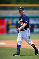Montgomery Biscuits pitching coach R.C. Lichtenstein (18) walks back to the dugout during a game against the Biloxi Shuckers on May 8, 2018 at Montgomery Riverwalk Stadium in Montgomery, Alabama.  Montgomery defeated Biloxi 10-5.  (Mike Janes/Four Seam Images)
