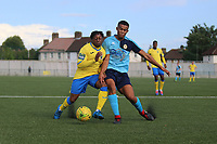 Michael Ademiluyi of Haringey and Jett Hogan of Stanwa during Haringey Borough vs Stanway Rovers, Emirates FA Cup Football at Coles Park Stadium on 25th August 2018