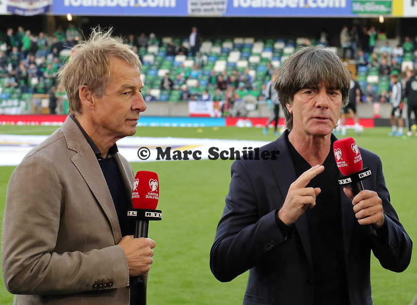 Ex-Bundestrainer und RTL-Experte Jürgen Klinsmann und sein Nachfolger Bundestrainer Joachim Loew (Deutschland Germany) - 09.09.2019: Nordirland vs. Deutschland, Windsor Park Belfast, EM-Qualifikation DISCLAIMER: DFB regulations prohibit any use of photographs as image sequences and/or quasi-video.