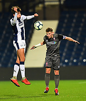 Lincoln City U18's Charlie West heads clear under pressure from  West Bromwich Albion U18's Zak Brown<br /> <br /> Photographer Andrew Vaughan/CameraSport<br /> <br /> FA Youth Cup Round Three - West Bromwich Albion U18 v Lincoln City U18 - Tuesday 11th December 2018 - The Hawthorns - West Bromwich<br />  <br /> World Copyright &copy; 2018 CameraSport. All rights reserved. 43 Linden Ave. Countesthorpe. Leicester. England. LE8 5PG - Tel: +44 (0) 116 277 4147 - admin@camerasport.com - www.camerasport.com