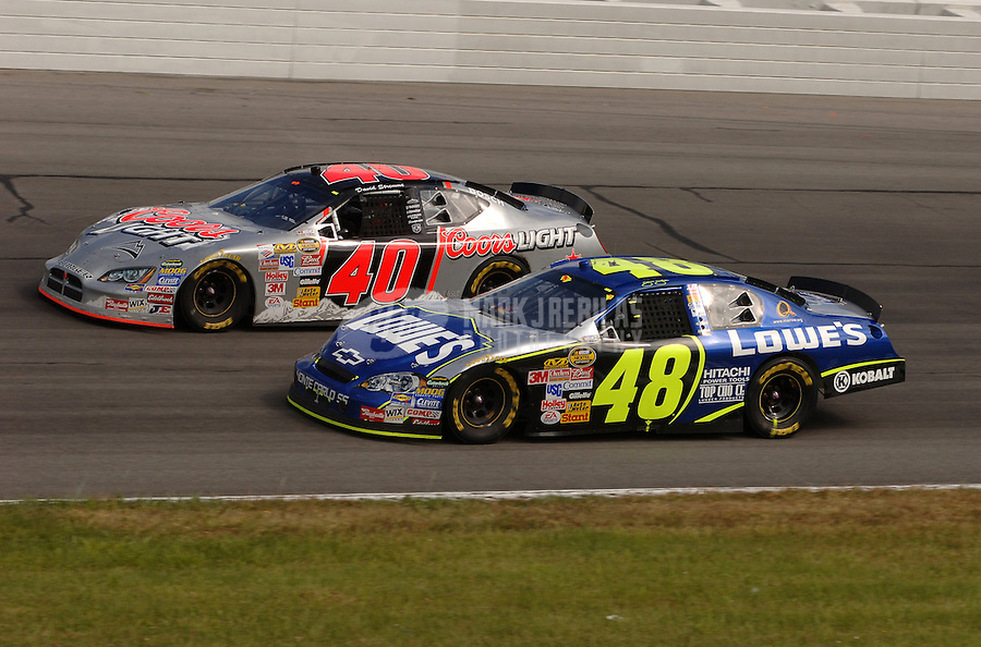 June 11, 2006; Long Pond, PA, USA; Nascar Nextel Cup driver Jimmie Johnson (48) races David Stremme (40) during the Pocono 500 at Pocono Raceway. Mandatory Credit: Mark J. Rebilas..