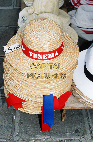 Venezia straw hats for sale outside a shop, Venice, Italy