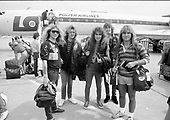 IRON MAIDEN - L-R: Dave Murray, Adrian Smith, Steve Harris, Nicko McBrain, Bruce Dickinson - arrival at Okecie Airport in Poland at the start of the World Slavery Tour in Warsaw Poland - August 1984. Photo credit: George Bodnar Archive/IconicPix