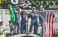John Pew, Oswaldo Negri Jr., AJ Allmendinger and Justin Wilson celebrate in victory lane after winning the Rolex 24 at Daytona, Daytona International Speedway, Daytona Beach, FL, January 2011.  (Photo by Brian Cleary/www.bcpix.com)