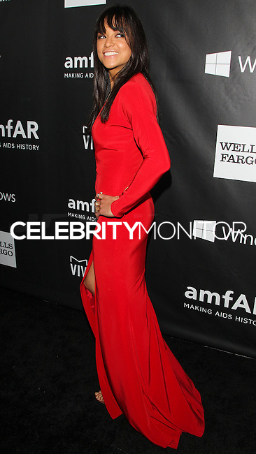 HOLLYWOOD, LOS ANGELES, CA, USA - OCTOBER 29: Michelle Rodriguez arrives at the 2014 amfAR LA Inspiration Gala at Milk Studios on October 29, 2014 in Hollywood, Los Angeles, California, United States. (Photo by Celebrity Monitor)