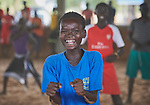 A boy smiles as he participates in recreational activities sponsored by Jesuit Refugee Service in the Doro Refugee Camp in Maban, South Sudan. The camp is one of four in Maban that together shelter more than 130,000 refugees from the Blue Nile region of Sudan. The recreational program is one of several psycho-social activities that JRS carries out in the camp.<br /> <br /> Misean Cara supports the work of JRS in the Maban camps.