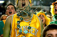 Lynden senior Jesse Neff, 17, cheers as Lynden plays Centralia during the third round of the Washington 2A state tournament at the Tacoma Dome on Friday, March 9, 2007..