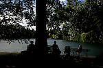 People relax close to the Grosse see or big lake at Nymphenburg palace in Munich, Germany, August 04, 2008. (ALTERPHOTOS/Alvaro Hernandez)