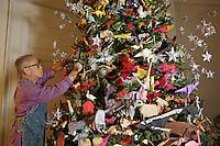 OrigamiUSA artists preparing the models and designing the Holiday Tree at the American Museum of Natural History. Talo Kawasaki placing models on the tree.