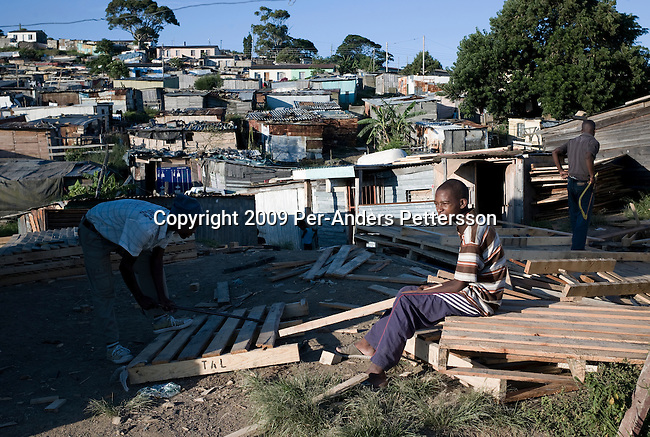EAST LONDON, SOUTH AFRICA - MARCH 9: Young men build and sell wooden shacks on March 9, 2009, in Duncan Village a poor township outside East London, South Africa. This area is one of the most popular ANC areas and many of its leaders grew up in the Eastern Cape province. Many people are disappointed in the ruling party and after 15 years of power, people?s lives have not changed much to the better. In Duncan Village, there?s lack of service delivery such as housing, electricity, and running water. Garbage is left on the streets and the municipality is only collecting it once a week, or they often skip a week. About 23 million South Africans are registered to vote on the April 22 national election. Jacob Zuma will most likely be the third elected head of a democratic South Africa. (Photo by: Per-Anders Pettersson/Getty Images)...