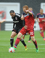 Washington, D.C.- March 29, 2014. Jeff Larentowicz of the Chicago Fire goes against Fabian Espindola (9) of D.C. United. The Chicago Fire tied D.C. United 2-2 during a Major League Soccer Match for the 2014 season at RFK Stadium.