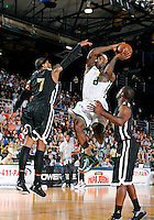 NBA player LeBron James shoots against Carmelo Anthony at the South Florida All Star Classic held at FIU's U.S. Century Bank Arena, Miami, Florida. .
