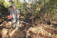 NWA Democrat-Gazette/FLIP PUTTHOFF <br /> Tom Waggoner trims vegetation Oct. 21 2016 along the trail to Sweden Creek Falls.