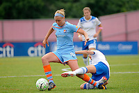 Kelly Smith (10) of the Boston Breakers goes for a tackle on Allie Long (10) of Sky Blue FC. Sky Blue FC and the Boston Breakers played to a 0-0 tie during a Women's Professional Soccer (WPS) match at Yurcak Field in Piscataway, NJ, on June 12, 2011.