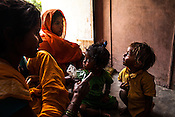 25 year old Dayawati (centre) lets her 17 month son, Naresh Mukhiya (right) play with another child while they wait to meet the Health post incharge at the local health centre in Hanuman Nagar in Saptari, Nepal. <br /> Naresh Mukhiya was first admitted on July 17, 2013 when he was 9 months old. MUAC - 109 mm, Weight - 5.5kg, and Height - 65 cm. He was discharged on Oct 1st, 2013. MUAC at the time of discharge - 123, Weight - 6.5 Kg, Height - 66cm. Total RUTF consumes - 148 sachets.Gain of weight - 2gm.day.
