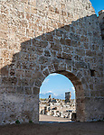 Ancient wall of the Roman Gate with carved stone at Perge near Antalya Turkey
