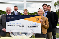 Connections of Youkan are presented with their cheque after winning The Simon & Nerys Dutfield Memorial Novice Stakes  during Afternoon Racing at Salisbury Racecourse on 18th May 2017