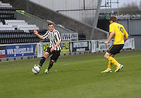 Ross Meechan being closed down by Luke Leahy in the St Mirren v Falkirk Clydesdale Bank Scottish Premier League Under 20 match played at St Mirren Park, Paisley on 30.4.13. .
