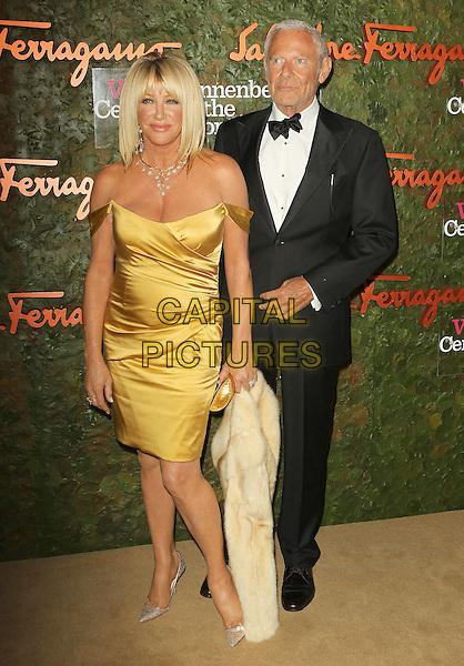 Suzanne Somers, Alan Hamel<br /> Wallis Annenberg Center For The Performing Arts Inaugural Gala held at Wallis Annenberg Center For The Performing Arts,  Beverly Hills, California, USA, 17th October 2013.<br /> full length yellow dress off the shoulder silk satin black bow tie tuxedo tux <br /> CAP/ADM/KB<br /> &copy;Kevan Brooks/AdMedia/Capital Pictures