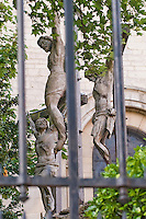 Christ and 2 Criminals on Crucifixes.  Scene representing the crucifixion of Jesus in a secluded corner of the garden of Saint Pierre de Montmartre, Paris, France.
