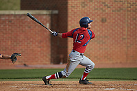 Justin Etts (12) of the NJIT Highlanders follows through on his swing against the High Point Panthers at Williard Stadium on February 18, 2017 in High Point, North Carolina. The Panthers defeated the Highlanders 11-0 in game one of a double-header. (Brian Westerholt/Four Seam Images)