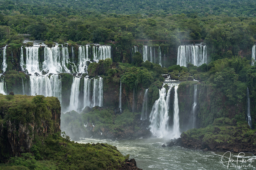 Iguazu Falls National Park in Argentina, as viewed from Brazil.  A UNESCO World Heritage Site.  Pictured from left to right are Mbigua and Bernabe Mendez Falls.