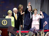 United States President George W. Bush claims victory at the  at the Ronald Reagan International Trade Center in Washington, D.C.  on November 3, 2004.  The President won a second term in a hard-fought campaign against United States Senator John F. Kerry (Democrat of Massachusetts) that attracted a record turn-out of voters.  From left to right: Lynne Cheney, US Vice President Dick Cheney, Jenna Bush, President Bush, first lady Laura Bush.<br /> Credit: Ron Sachs / CNP