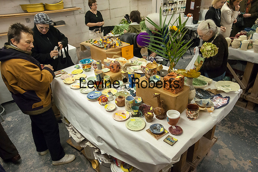 Members of a pottery studio in the New York neighborhood of Chelsea hold a holiday sale prior to Christmas on Saturday, December 1, 2012. (© Richard B. Levine)