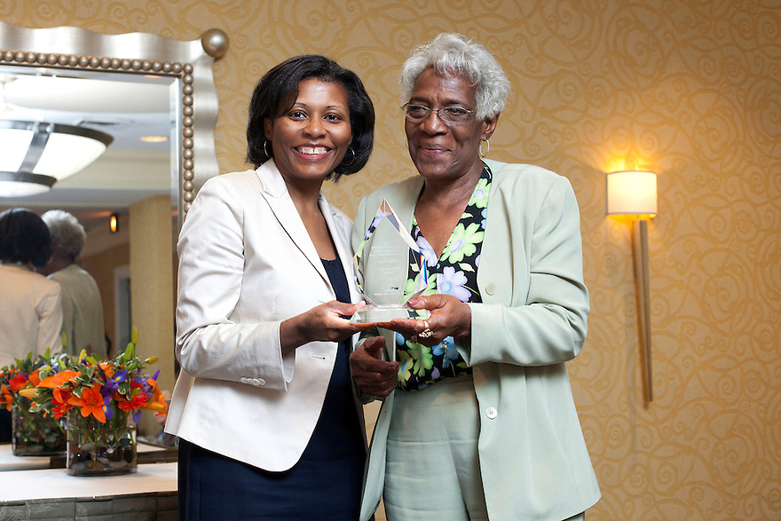 April Hawkins gives Clarie Miller her award at the Older Volunteers Enrich America Awards at the Double Tree Hotel in Washington, DC on Friday, June 17, 2011.