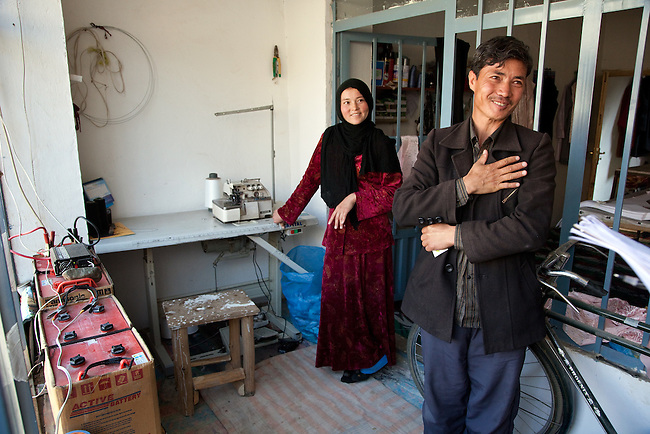 09 May 2012, Bamiyan, Afghanistan : Haisar Ali (34,right) part owner with his wife Masooma Ibrahim (25) of Poshak Jawanan tailoring at Mullah Ghulam village on the outskirts of Bamiyan. It is a small business venture looking to grow and expand both its workforce and output. It is benefiting from the Afghan Rural Enterprise Development Program (REDP). It has been in the program for three months and is hoping to find larger space to get more workers but is hamstrung by the lack of city power to drive its machinery. .The World Bank is funding the REDP in conjunction with the Afghan Government by providing assistance with training for employees, marketing for the products and arranging access to finance to expand and grow the small business venture . Picture by Graham Crouch/World Bank