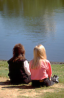 Women age 27 enjoying spring day at Loring Park Pond.  Minneapolis  Minnesota USA
