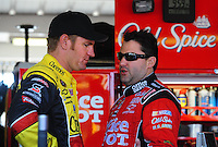 Apr 17, 2009; Avondale, AZ, USA; NASCAR Sprint Cup Series driver Tony Stewart (right) talks with Clint Bowyer during practice for the Subway Fresh Fit 500 at Phoenix International Raceway. Mandatory Credit: Mark J. Rebilas-