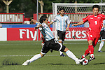 06 July 2007: Argentina's Sergio Aguero (left) gets a boot on the ball to knock it away from North Korea's Song Chol Pak (9). Argentina's Under-20 Men's National Team defeated North Korea's Under-20 Men's National Team 1-0 in a Group E opening round match at Frank Clair Stadium in Ottawa, Ontario, Canada during the FIFA U-20 World Cup Canada 2007 tournament.