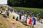 The peloton strung out on the cobbles during Stage 9 of the 2018 Tour de France running 156.5km from Arras Citadelle to Roubaix, France. 15th July 2018. <br /> Picture: ASO/Pauline Ballet | Cyclefile<br /> All photos usage must carry mandatory copyright credit (&copy; Cyclefile | ASO/Pauline Ballet)