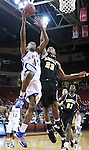 The Gazette Thomas Stone High School's Dytania Johnson, left, drives hard to the basket as Parkville High School's Jordan Jackson attempts the block during the two team's 4A state semi-final match up at Comcast Center in College Park on Thursday evening. Thomas Stone won the game 73-64 to go on to the finals.