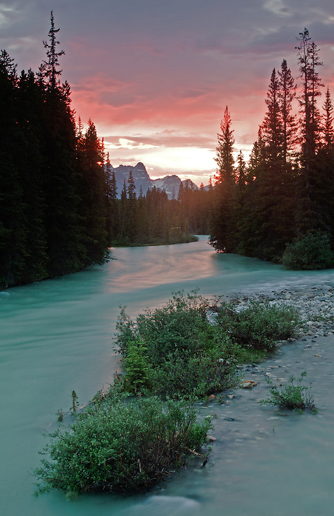 The Bow River at sunset in Lake Louise near Banff National Park, Alberta, Canada