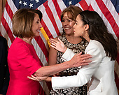 United States Representative Alexandria Ocasio-Cortez (Democrat of New York) prepares to hug Speaker of the US House of Representatives Nancy Pelosi (Democrat of California) after posing for a mock swearing-in photo with members of her family as the 116th Congress convenes for its opening session in the US Capitol in Washington, DC on Thursday, January 3, 2019.<br /> Credit: Ron Sachs / CNP<br /> (RESTRICTION: NO New York or New Jersey Newspapers or newspapers within a 75 mile radius of New York City)