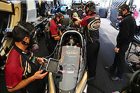 Aug. 18, 2013; Brainerd, MN, USA: Crew members with NHRA top fuel dragster driver Khalid Albalooshi warming up in the pits during the Lucas Oil Nationals at Brainerd International Raceway. Mandatory Credit: Mark J. Rebilas-